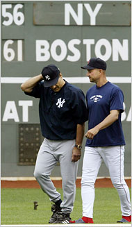 Courtesy of <em>New York Times</em>:  Joe Torre, left, and Terry Francona during a rare on-field meeting in Fenway Park in 2004.